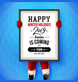 santa holding a massive poster vector image vector image
