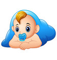 funny baby and pacifier lying with blue blanket vector image vector image