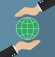 Hands holding globe vector image vector image