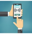 Hand holding smartphone with wifi vector image
