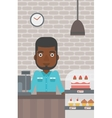 Worker standing behind the counter at the bakery vector image vector image