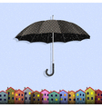 Umbrella in blizzard with colorful paper homes vector image