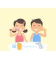 happy kids brushing teeth standing in bathroom vector image