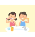 Happy kids brushing teeth standing in the bathroom vector image