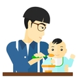 Man feeding baby vector image