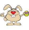 cartoon easter bunny holding an easter egg vector image vector image