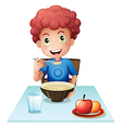 A curly boy eating his breakfast vector image vector image