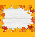 fallen leaves on white wooden background vector image vector image