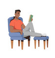 guy in armchair reading book hobat free time vector image vector image