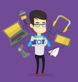 young man surrounded with his gadgets vector image vector image