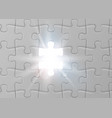 white jigsaw puzzle with missed and shining piece