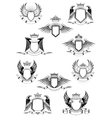 Heraldic winged shields with crowns and ribbon vector image vector image