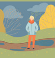 man wearing warm clothes standing on autumn season vector image