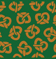 pretzels seamless pattern on green vector image vector image