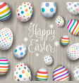 easter eggs on wood background vector image vector image