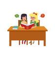little cartoon girls sitting at school desk vector image vector image