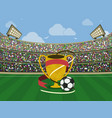soccer stadium and gold trophy with red ribbons vector image vector image