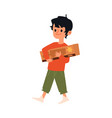 happy kid holding cardboard box with new toy truck vector image