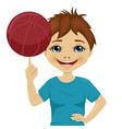 little boy spinning basketball ball with finger vector image vector image