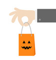 Businessman hand holding shopping paper bag