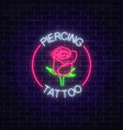 tattoo and piercing parlor glowing neon signboard vector image