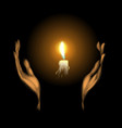hands holding a burning candle in dark vector image
