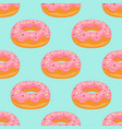 pink donuts pattern isolated on blue background vector image