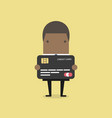 african businessman holding a credit card vector image vector image