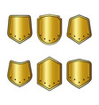 set of golden shields with stars in trendy flat vector image