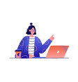 young smiling woman working at table on laptop vector image vector image