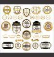 golden sale shields laurel wreaths and badges vector image vector image