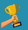 hand holding a trophy vector image vector image