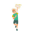 cartoon boy holding open book above head vector image vector image