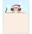Christmas monkey holding white banner Monkey vector image vector image