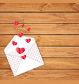 open envelope with scattered folded paper hearts vector image