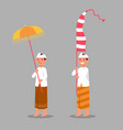 traditional balinese boy bring umbrella and long vector image vector image
