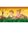 A girl and a boy playing with the butterflies vector image vector image