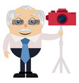 old man with red camera on white background vector image vector image
