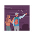 young people back view looking at starry night sky vector image vector image