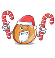 santa with candy bagels mascot cartoon style vector image vector image