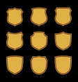 shield shape gold icons set simple flat logo on vector image vector image