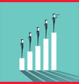 businessmen standing on a graph business success vector image