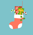 christmas sock with present boxes and candy cane vector image vector image