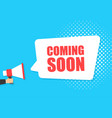 male hand holding megaphone with coming soon vector image vector image