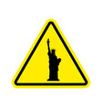 attention america statue of liberty on yellow vector image