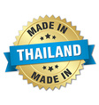 made in Thailand gold badge with blue ribbon vector image vector image