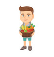 boy holding basket with fruit and vegetables vector image