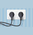 two black plug inserted in a wall socket on vector image vector image