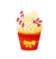 christmas cupcake with wrapped sweet lollipop can vector image