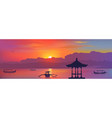 colorful balinese sunset with traditional gazebo vector image vector image